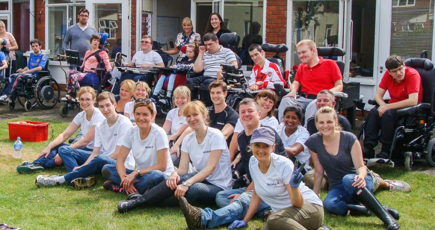 group of disabled people with volunteers