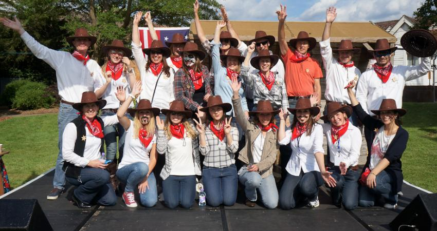 team of volunteers in Wild West dress